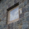 Sundial painted in a niche