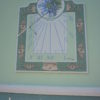 Frescoed sundial on panel anchored to the wall